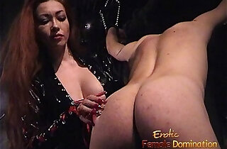 Slim stunner wearing latex has some dungeon fun with a bald stud xxx tube video